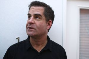 Todd Glass reenacts his high school graduation photo